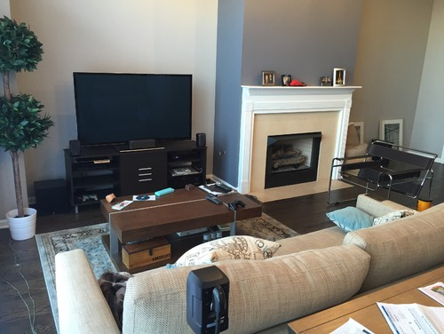 How to arrange furniture open floor plan side by side TV and fireplace
