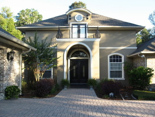 And here, with taupe/earthy house color and black roof, white trim: