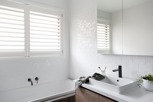 All white bathroom with timber vanity and gunmetal tapware inhabitat interiors