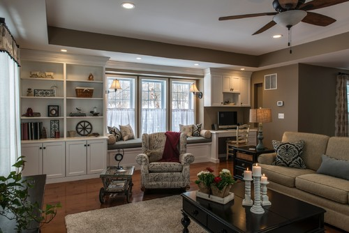 Great Room Built In With Book Shelves And Desk. Kitchen Trim And Beam  Detail Add Interest To The Space. Earth Tone Paint Colors.