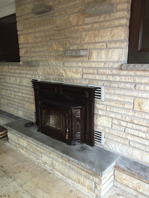 Dark Wood veneer walls - grey / beige brick fireplace