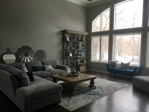 Can anyone help me visually arrange them and tell me how many more I need and what size? I have included pics of my entire living room for perspective. & Need advice regarding living room wall collage