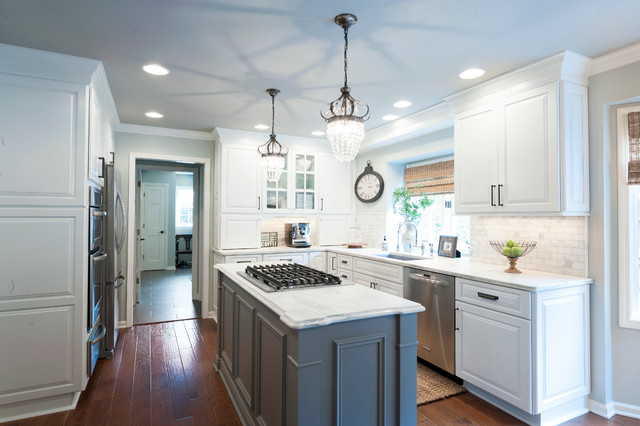 kitchen with white perimeter cabinets and a gray island transitional