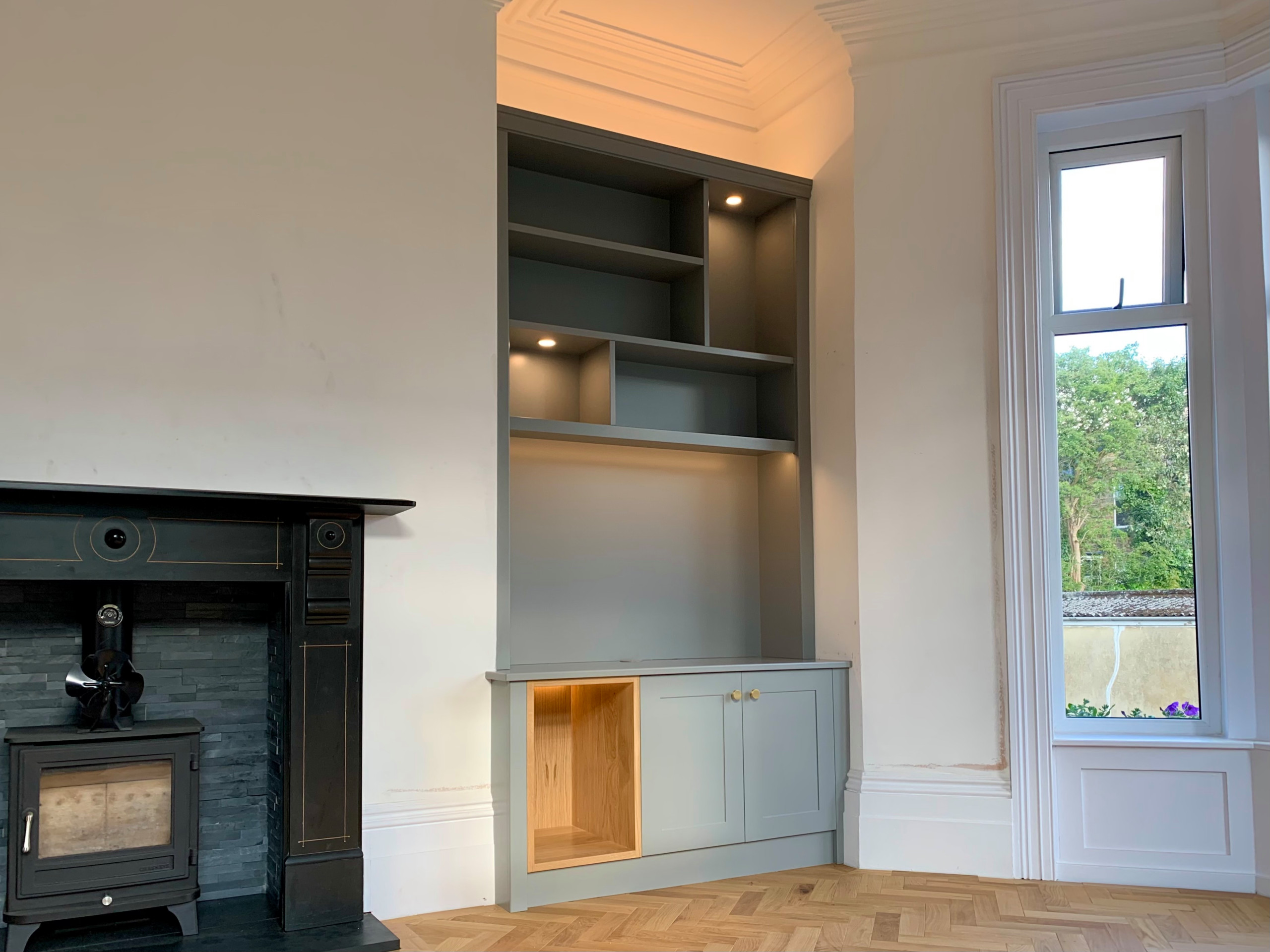 Classic/Modern Mix bookcase with lighting and shaker cabinet doors and oak log s
