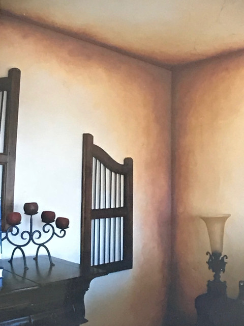 Mid-sized tuscan master bedroom photo in Orange County with beige walls