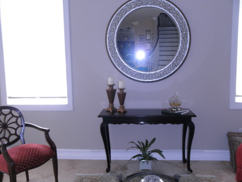 What do i put under this large round mirror for Large round mirror for living room