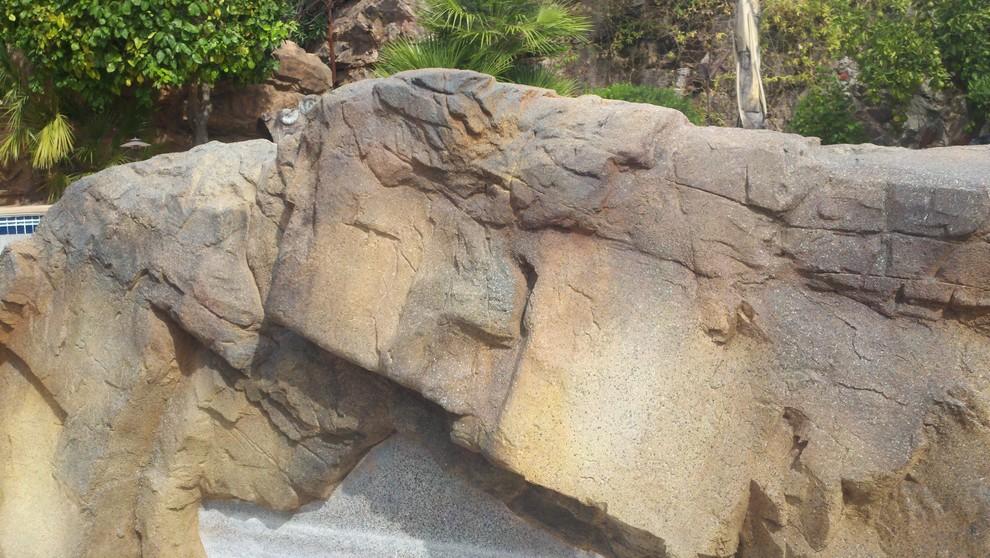 Renovation of shotcrete artificial rocks.