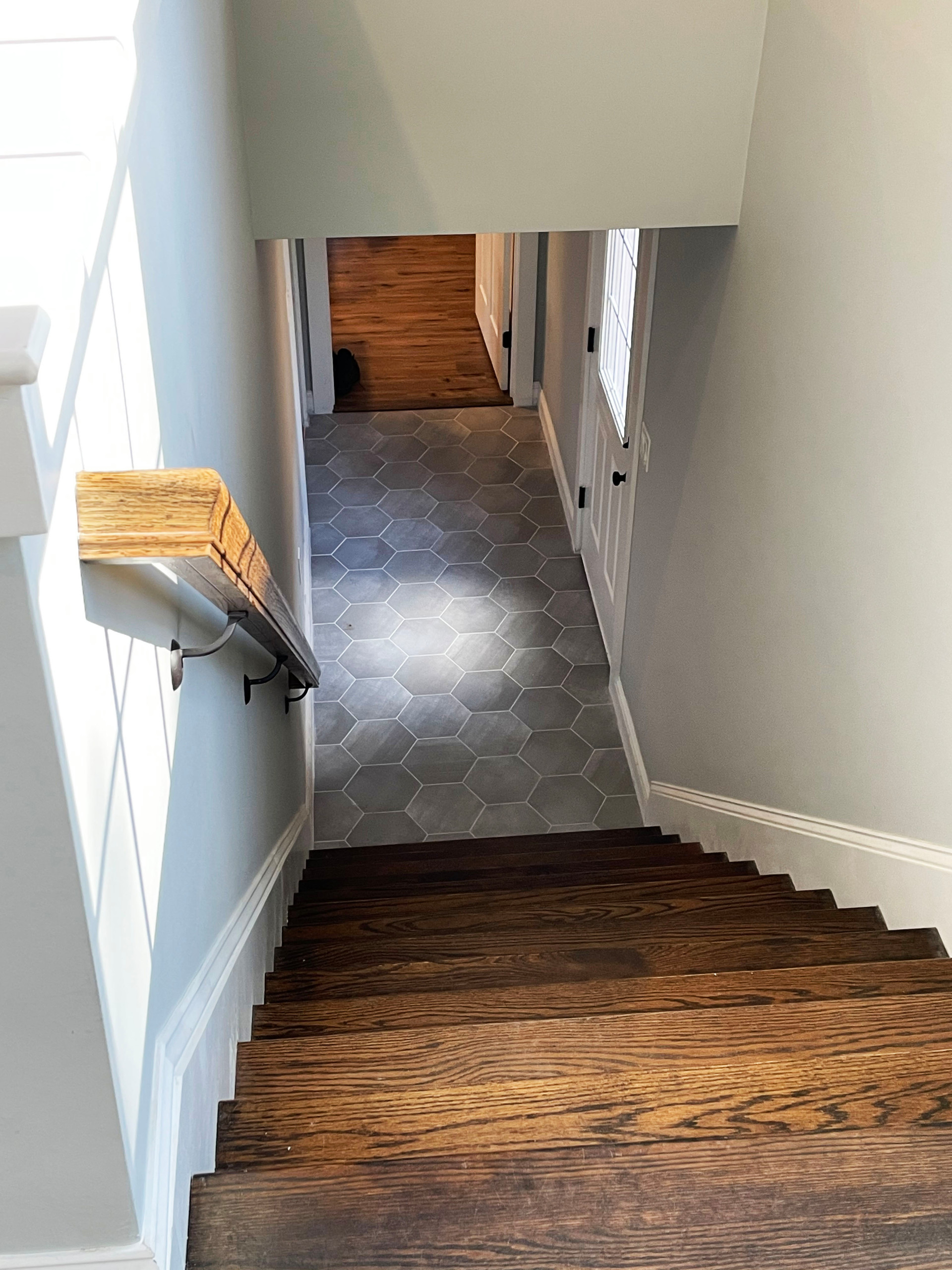 Stairs to lower level of home and in law spaces