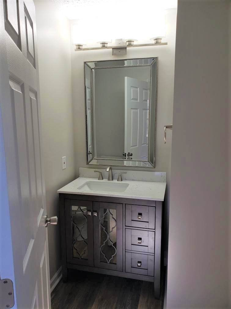 Two Bathroom Renovations and Custom Closet Shelving with Custom Tile Showers