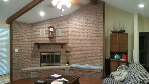 Corner Brick Fireplace With Vaulted Ceiling