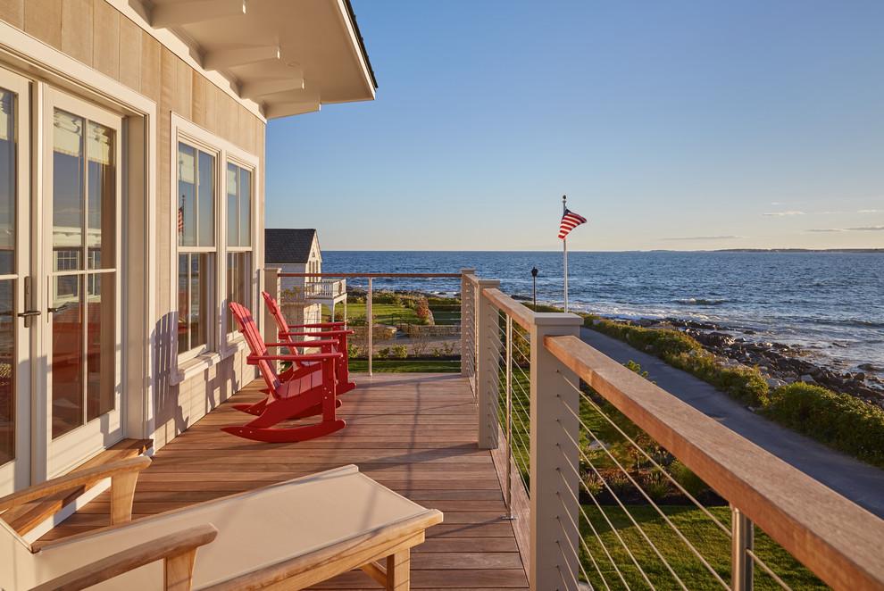 Beach style home design photo in Portland Maine