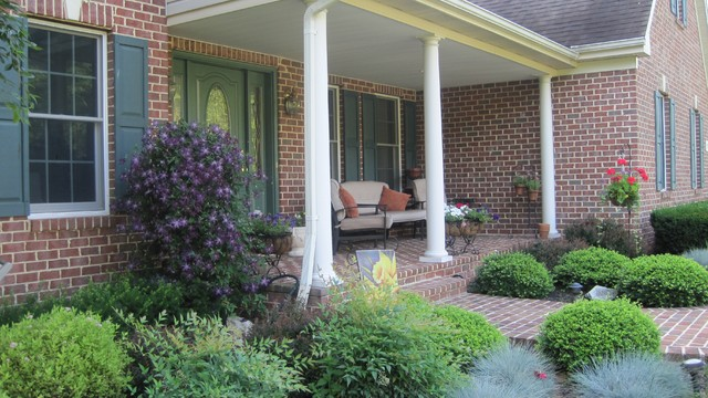 Brick Front Porch With Colorful Landscape