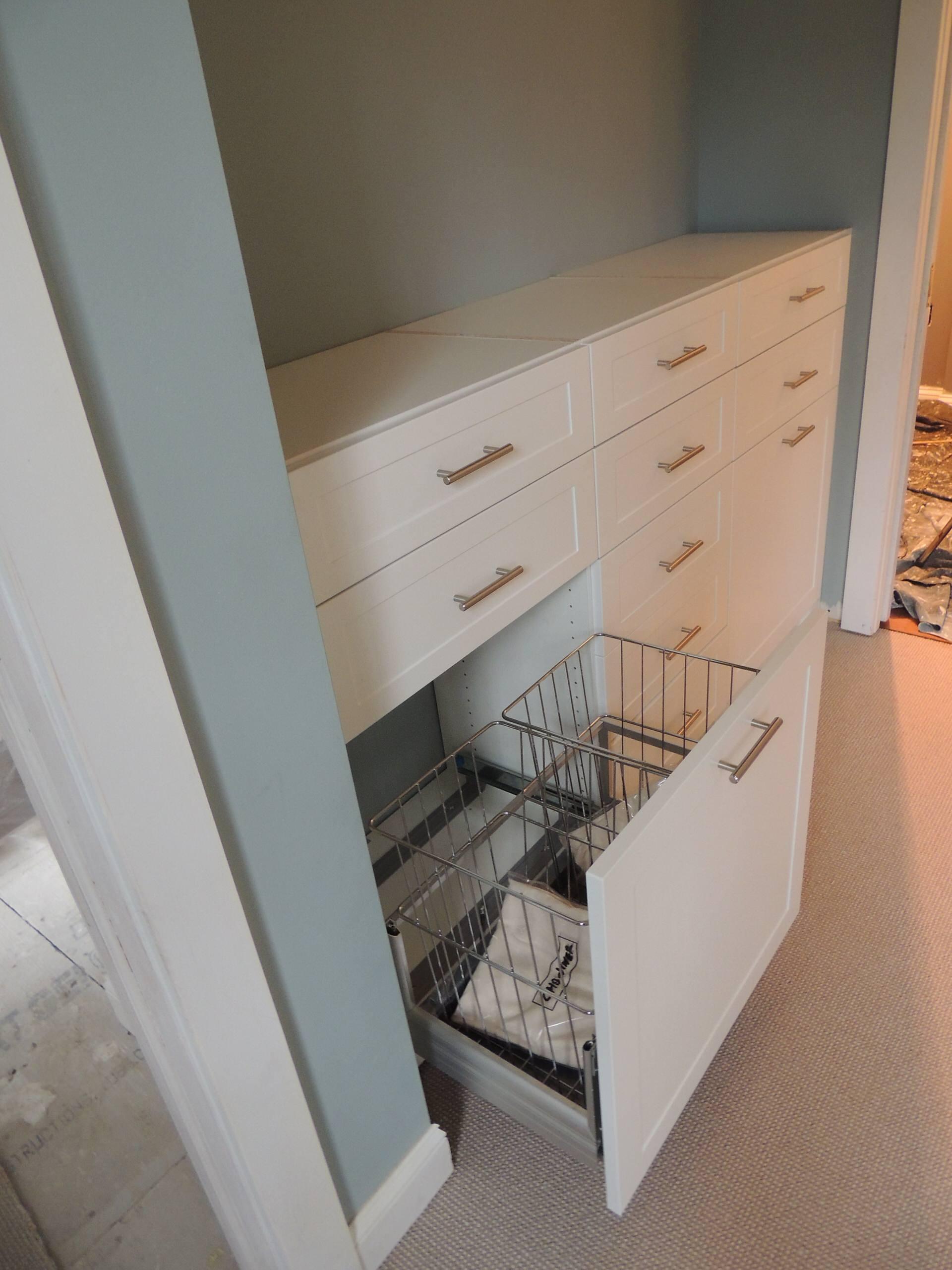 Hamper unit built into a small nook.