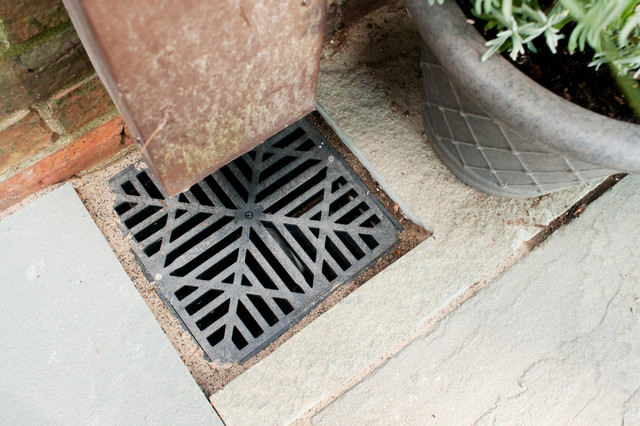 An attractive drain grate for the downspout traditional