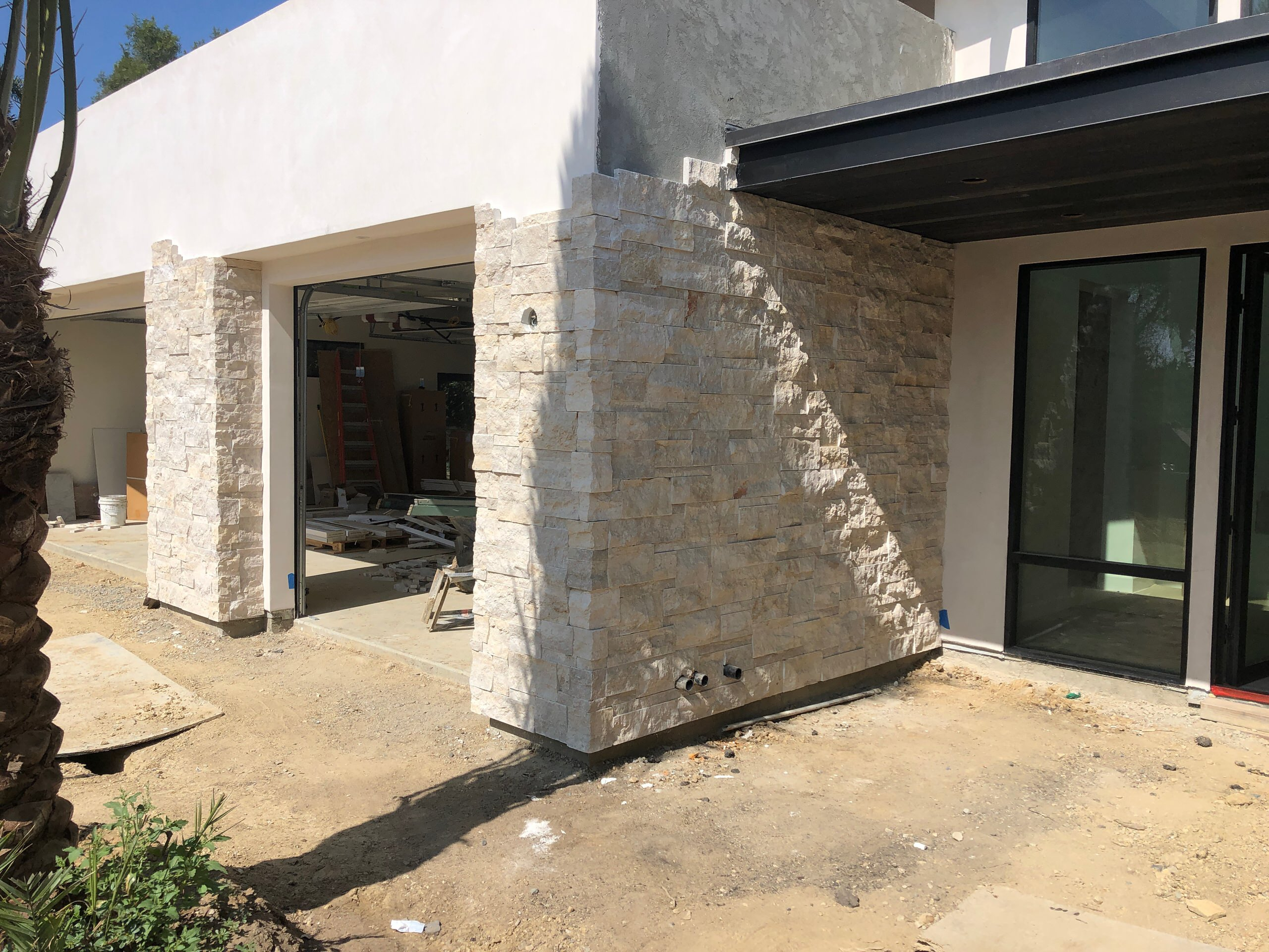 Installing Stone Veneer to a House & Garage Wall