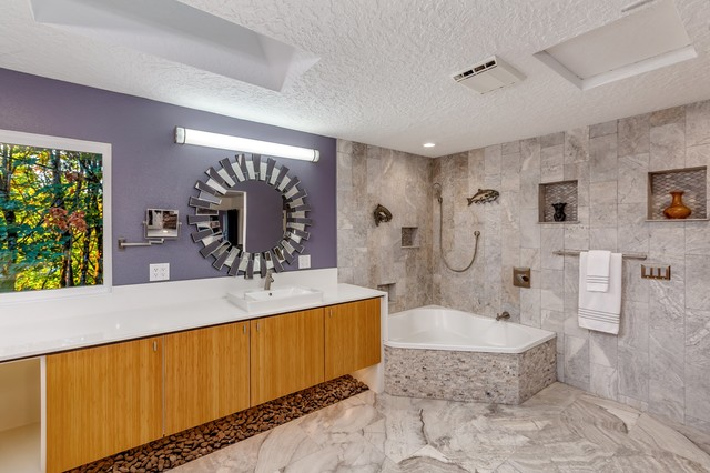 Example of a large minimalist master travertine floor and gray floor bathroom design in Portland with flat-panel cabinets, light wood cabinets, a one-piece toilet, purple walls, a drop-in sink, engineered quartz countertops and white countertops