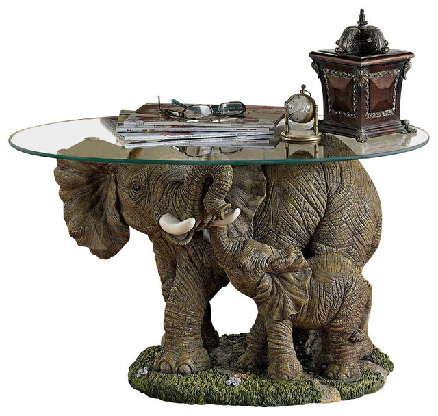 elephant's majesty glass-topped cocktail table - mediterranean