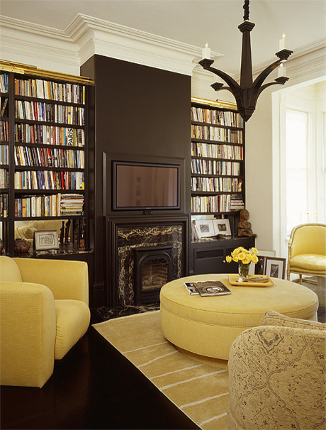 Black and Yellow library with recessed flat screen eclectic family room