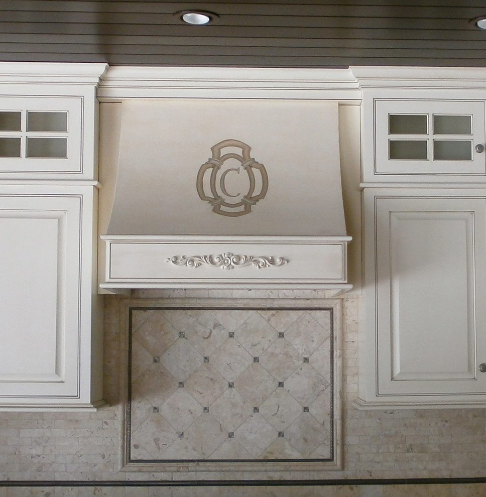 Summer kitchen. Stove hood plastered and monogram painted.