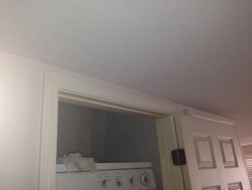 door frame would interrupt crown molding