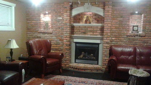 I have a brick wall fireplace that I would like to modernize and brighten up but I am scared to go with white and get a