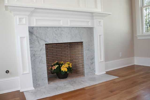 Carrara marble fireplace on this beautiful master bedroom. This is part of a new construction job by one of our client Toth builders out of Westport