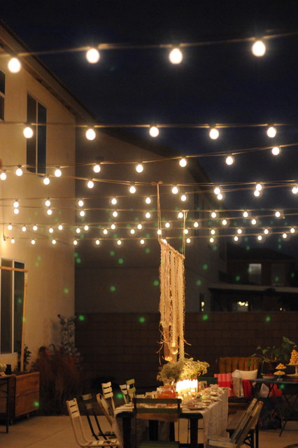 houzz holiday contest a pretty backyard dinner party eclectic backyard party lighting ideas