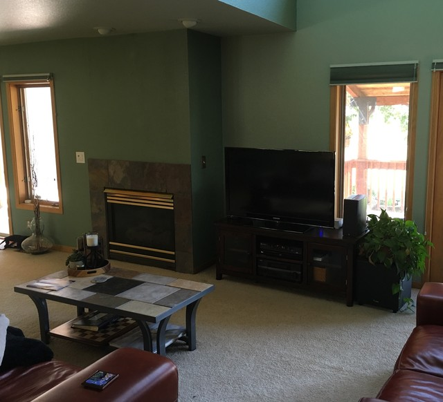 before picture of older fireplace and dark paint colors