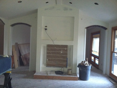 We are putting in a double sided wood burning fireplace that sits between the family room and living room. It is in black matte finish. Two archways are on either side of it. TV above it on the LR side. We need help selecting the right stone and design for both sides. We want them related but not id...