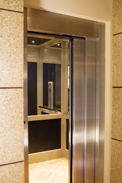 Custom residential elevator with sliding doors modern for Custom home elevator