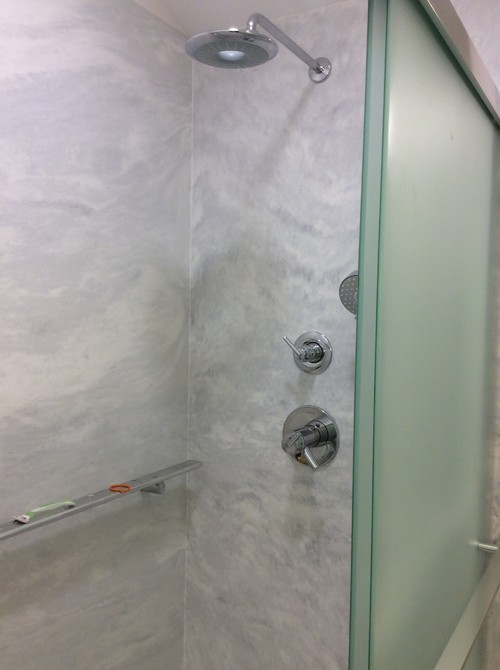 one with the shampoo is much darker on lower half but that kind of saved our butts when they had to rip out and redo the panel with the shower head