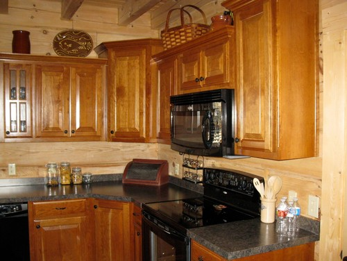Countertops And Backsplash In Log Home Kitchen
