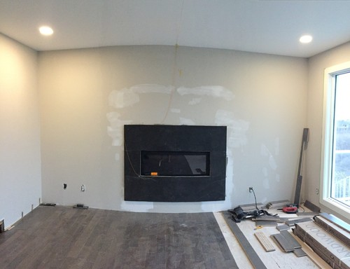 Black Stone Fireplace Surround Looks Out Of Proportion