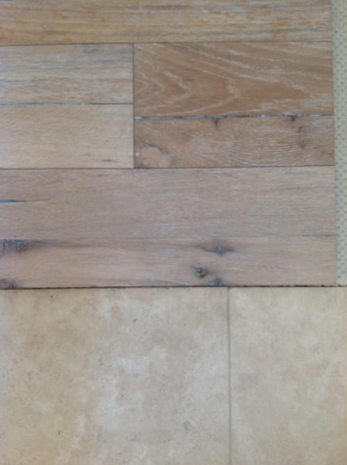 Does a rustic hardwood floor look good in house with nice travertine
