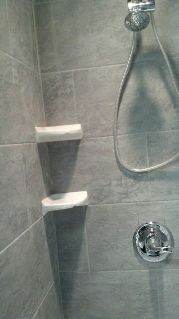 Stone Shower With White Corner Shelves Traditional