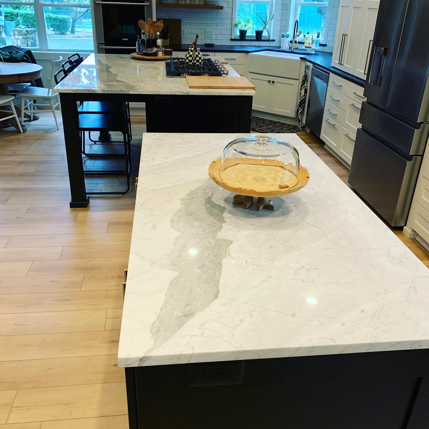crisp white background and dramatic bold grey veining, Statuarietto Marble