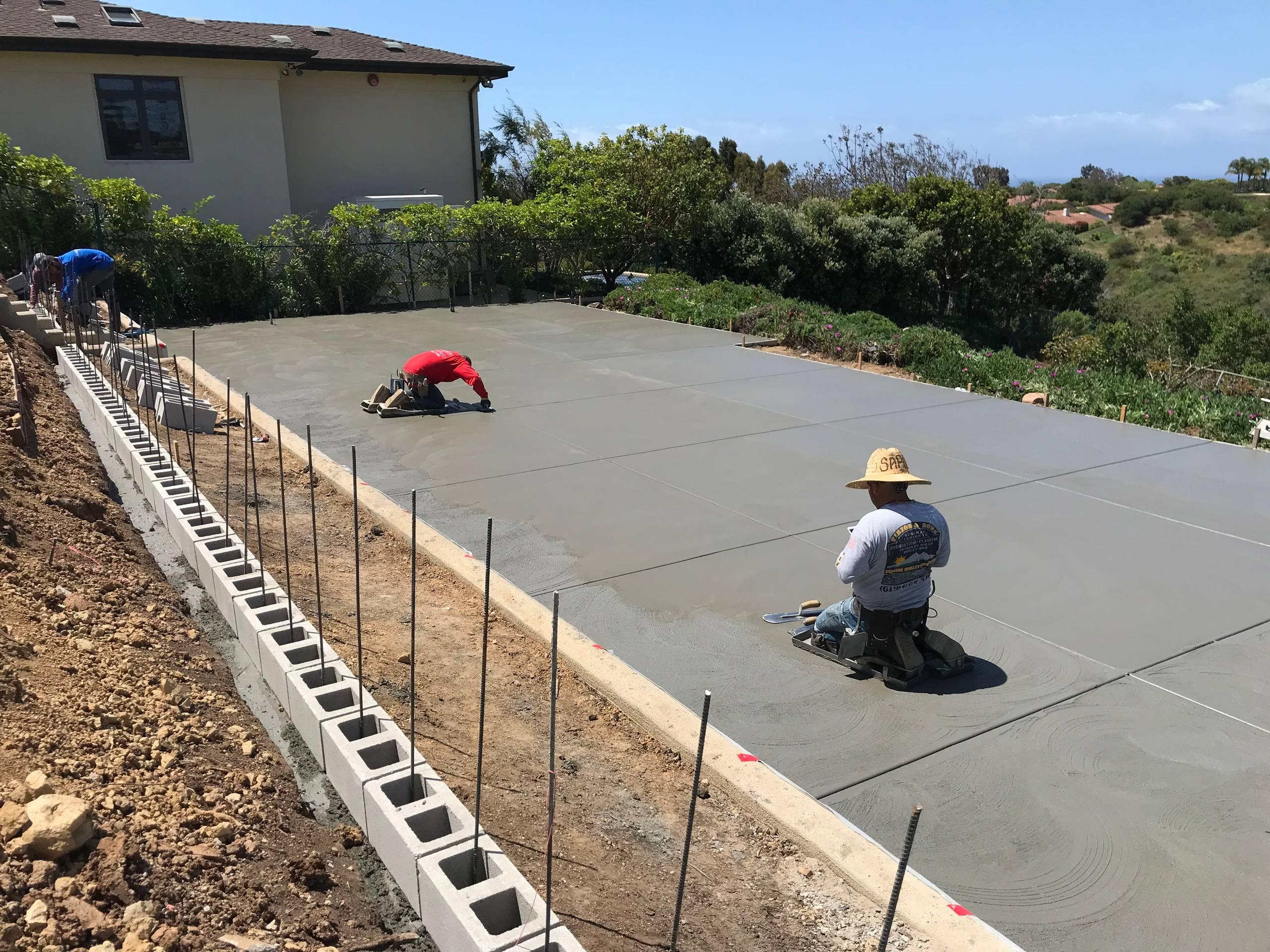 Large Concrete Slab in Backyard