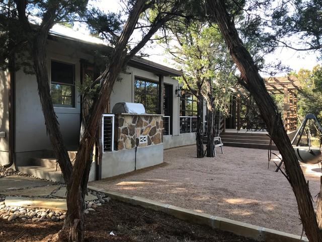 Mountain style home design photo in Austin
