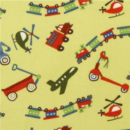 green Riley Blake flannel fabric train airplane scooter