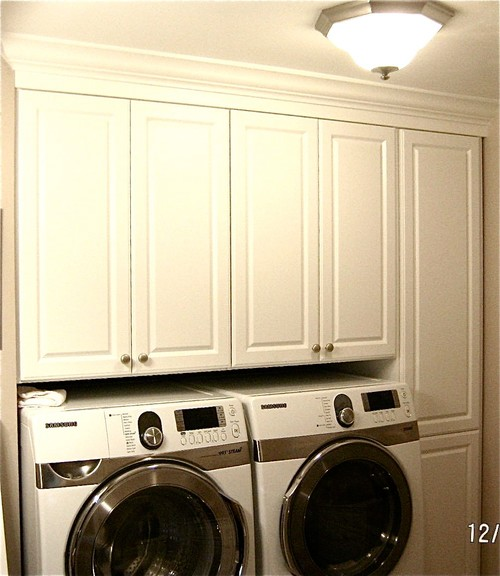 easier access to upper laundry cabinets! Above Washer Cabinets