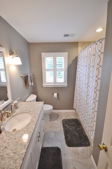 Example of a large transitional home design design in Philadelphia