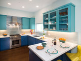 Blue and Aqua Cabinets Make a Splash in a Colorful Kitchen (12 photos)