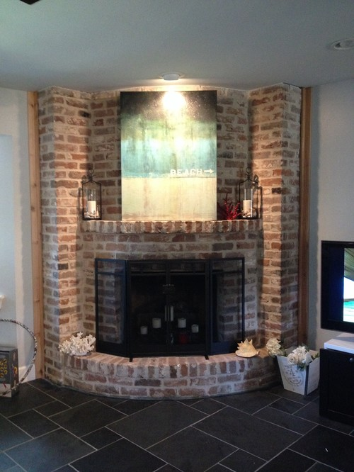 I have a corner fireplace that is curved and original 1960s brick from floor to ceiling. We recently had the flooring replaced to a dark slate. I would like to have a dark stained cedar rustic look mantel added but the curve may make it difficult. Any ideas on this design and how I could tackle this...