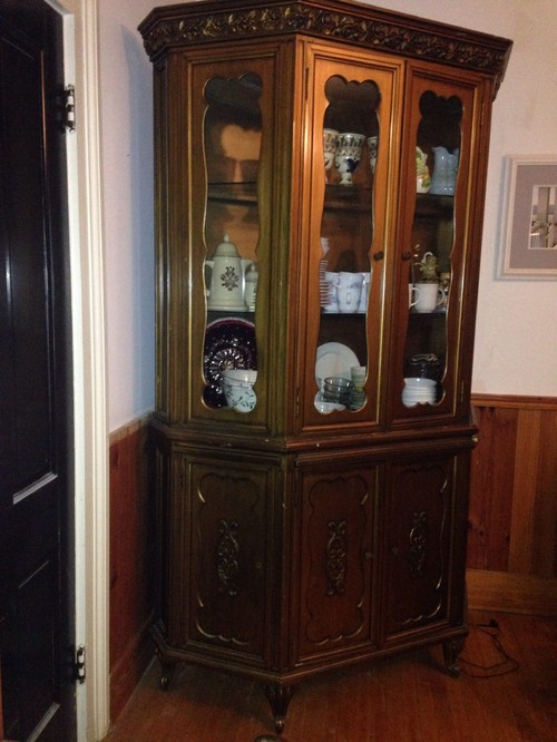I am trying to get an idea of how much this is worth. Its a wooden china  cabinet with a gold paint finish and glass doors. There is a light inside. - What Is This Antique China Cabinet With Gold Paint Finish Worth?