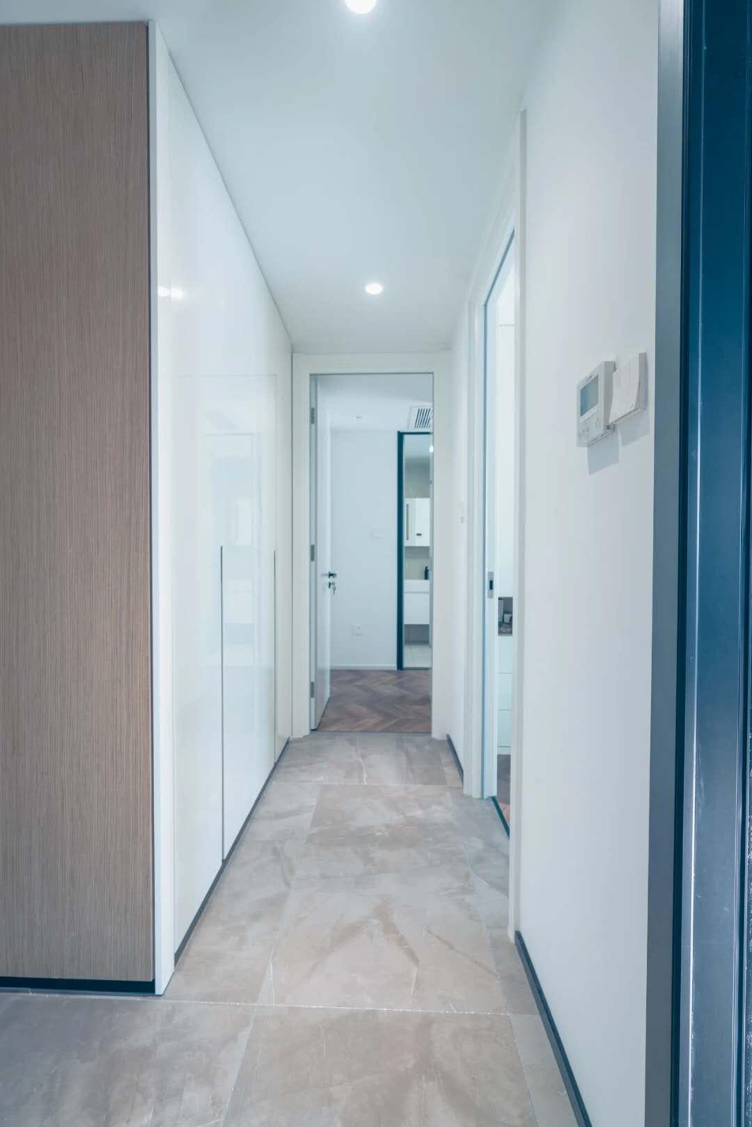 Hallway tile flooring cutom hidden storage cabinet wall