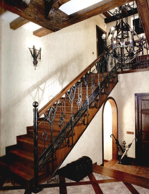 Интерьер в индустриальном и лофт стиле, кованые перила для лестницы, люстры, бра loft-lestnitsa