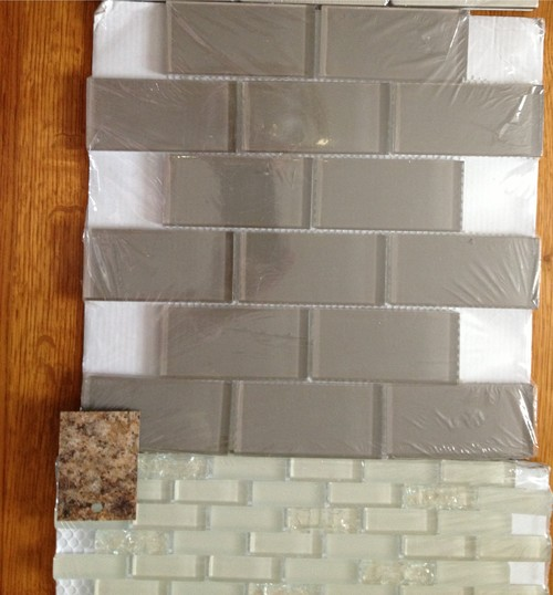 I am thinking of putting an off-white glass tile backsplash, that has a  hint of sparkle on some of the tiles, with a greige subway tile backsplash  above the ...