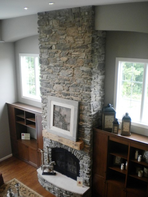 This is a picture of a floor to ceiling fireplace we did for one of contractors this past year. It features a wood beam style mantle and Eldorado Stone Teton