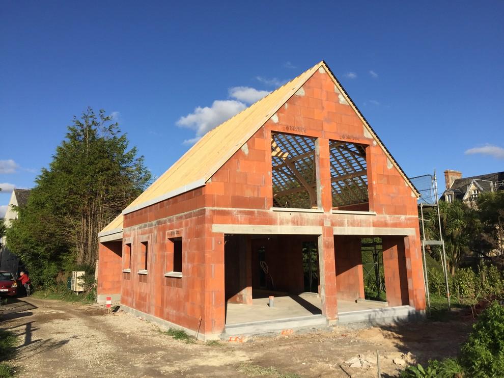 Construction d'une maison neuve en bord de mer