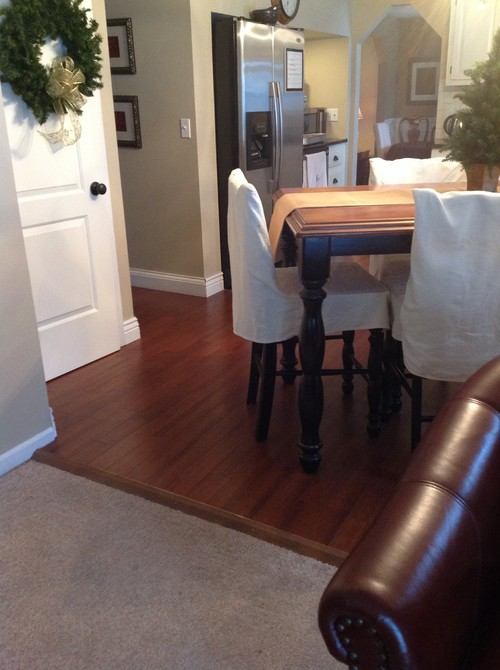 How to transition wood flooring between rooms for Flooring transition from kitchen to family room
